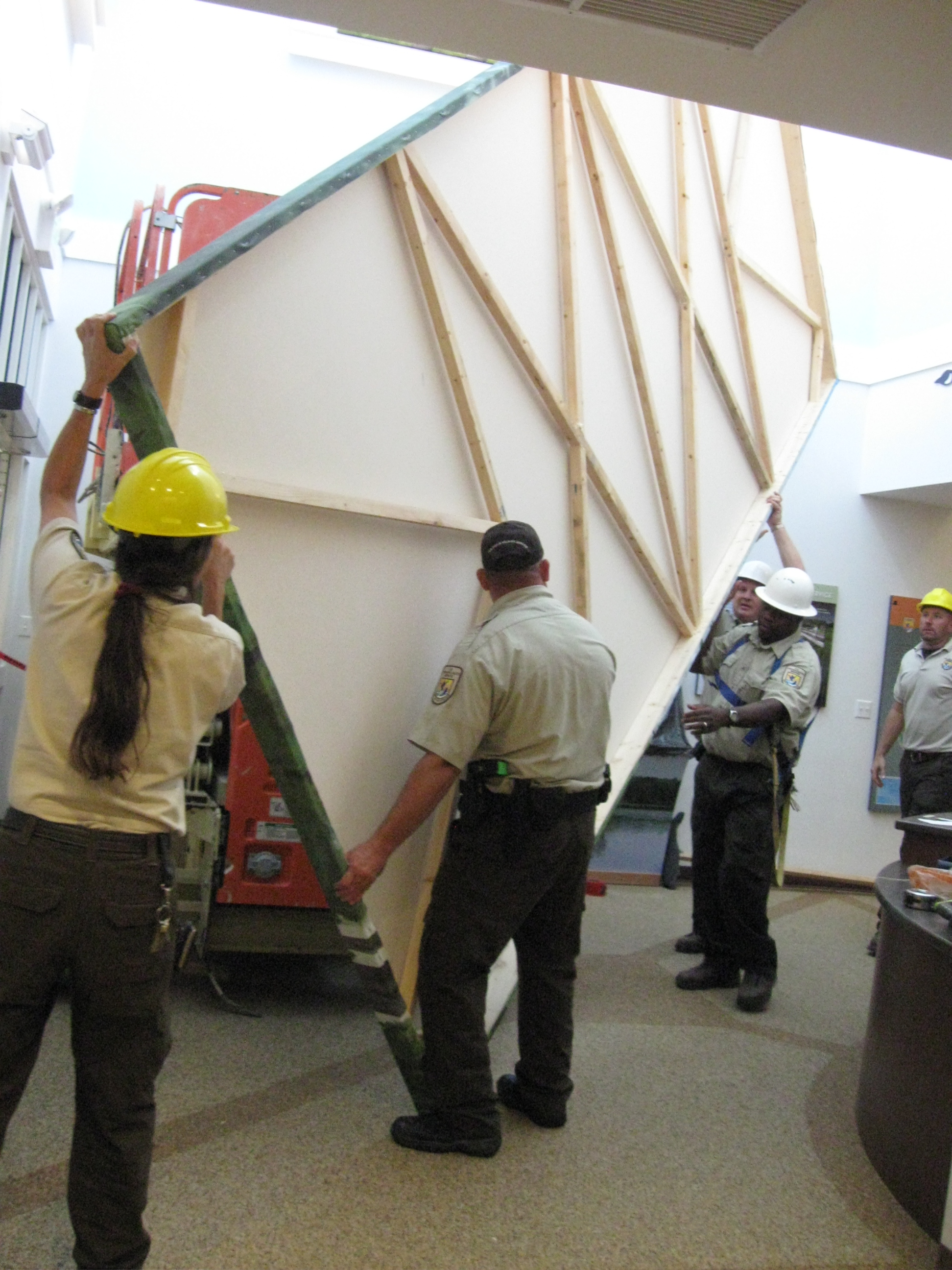 FWS staff begin to raise one of the four panels into position